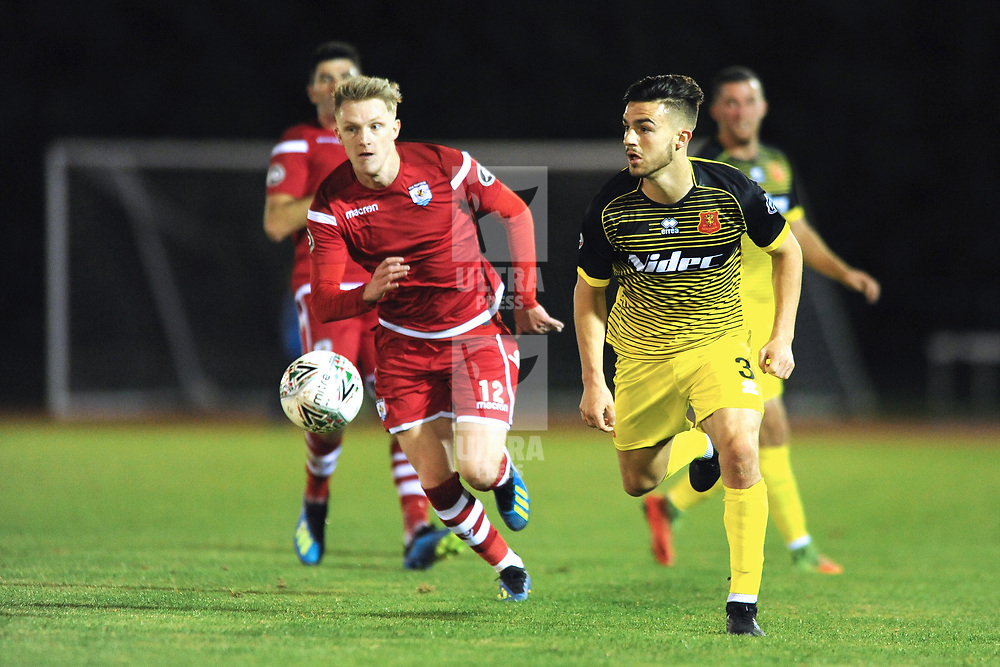 14/9/2018 - Callum Roberts of Newtown sprints clear of Declan Poole of Connah's Quay during the JD Welsh Premier League fixture between Connah's Quay Nomads and Newtown AFC at Deeside Stadium<br /> <br /> Pic: Mike Sheridan/County Times/Newsquest North Wales<br /> MS220-2018