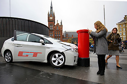© Licensed to London News Pictures. 15/11/2016. London, UK. People look at a car crash stunt to promote Amazon Prime's forthcoming series 'The Grand Tour' in King's Cross Square, London on 15 November 2016. Photo credit: Tolga Akmen/LNP