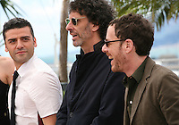Oscar Isaac, Joel Coen, Ethan Coen at the Coen brother's new film 'Inside Llewyn Davis' photocall at the Cannes Film Festival Sunday 19th May 2013