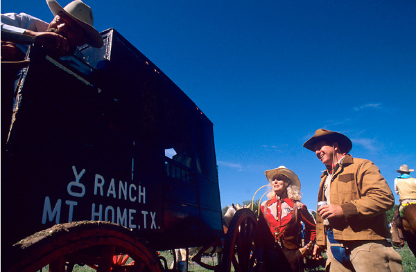group standing around an old western wagon