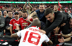 Ashley Young of Manchester United celebrates winning the FA Cup with the fans - Mandatory by-line: Robbie Stephenson/JMP - 21/05/2016 - FOOTBALL - Wembley Stadium - London, England - Crystal Palace v Manchester United - The Emirates FA Cup Final