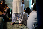 "A detail of drug addict transvestite's feet, in Edhi rehabilitation center. North side of Karachi, Pakistan on Sunday, December 7 2008.....""Not men nor women"". Just Hijira, Kusra. Painted lips, Kajal surrounding their eyes and colourful veils..Pakistan is today considered a strongly, foundamentalist as well, islamic country. But under its reputation, above all over the talebans' continuos advancing, stirs a completely extraneous world, a multiethnic mixed society. Transvestites make part of it, despite this would not be admitted by a strict law. Third gender, the Hijira are born as men (often ermaphrodites) or with an ambiguous genital situation, and they have their testicles and penis removed through a - often brutal - surgical operation. The peculiarity is that this operation does not contemplate the reconstruction of a female organ. This is the reason why they are not considered as men nor women, just Hijira. They are often discriminated, persecuted  and taxed with being men prostitutes in the muslim areas. The members of this chast perform dances during celebrations, especially during weddings, since it is anciently believed that an EUNUCO's dance and kiss in the wedding day brings good luck to the couple's fertility...To protect the identities of the recorded subjects names and specific .places are fictionals."