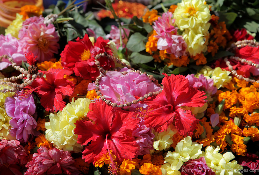 Asia, Nepal, Kathmandu. Flowers and heart shaped beads form the display of a street market vendor outside Bodnath Stupa.