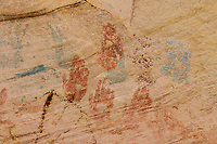 Hand prints in red and green pigment pictographs around Monarch Cave ruins on Comb Ridge; Cedar Mesa, UT