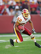 LANDOVER, MD - NOVEMBER 26:  Antwaan Randle El #82 of the Washington Redskins returns a punt against the Carolina Panthers at FedExField on November 26, 2006 in Landover, Maryland. The Redskins defeated the Panthers 17-13. ©Paul Anthony Spinelli *** Local Caption *** Antwaan Randle El