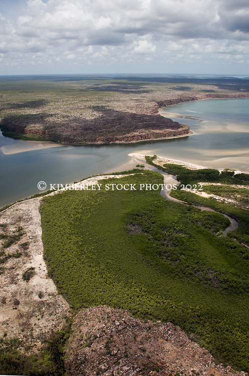 Storms build over the mouth of the King George River where the river meets the Kimberley coast.