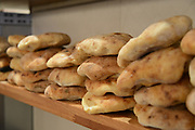 Freshly baked hand made pita bread in a bakery