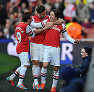 Arsenal's Thomas Rosicky &reg; celebrates after scoring his sides 3rd goal of the game with Arsenal's Santi Cazorla and Captian Mikel Arteta  during Barclays Premier League , Arsenal v Sunderland at the Emirates Stadium in London, England on Saturday 22nd Feb 2014.<br /> pic by John Fletcher, Andrew Orchard sports photography.