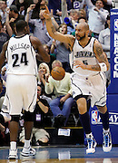 Utah Jazz forward Carlos Boozer (5) reacts as he runs past Paul Millsap after scoring against the Denver Nuggets during the first half of Game 4 of the NBA Western Conference first-round playoff series in Salt Lake City, Sunday, April 25, 2010. (AP Photo/Colin E Braley)