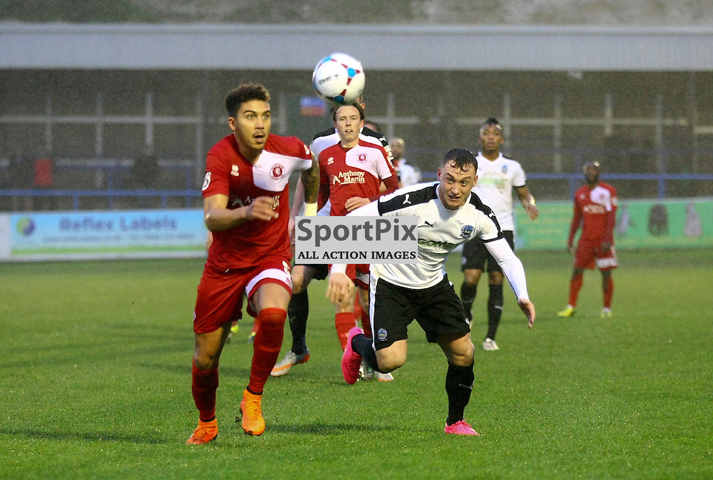 Welling's Harry Osborne (5) beats Dover's striker Ricky Miller (9) to the ball. The weather forced the game between Dover Athletic v Welling United to be abandoned shortly into the second half. Vanarama National League. 02  January 2016. (c) Matt Bristow | SportPix.org.uk
