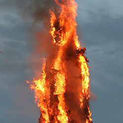 Anthony Gormley's 25-metre high Waste Man burns above Margate seafront on the Exodus film set