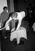 Mike Fitzroy diving into an ice bucket. Hotel bar in St. Moritz the night before the Dangerous Sports Club Ski race. 1985.<br />
