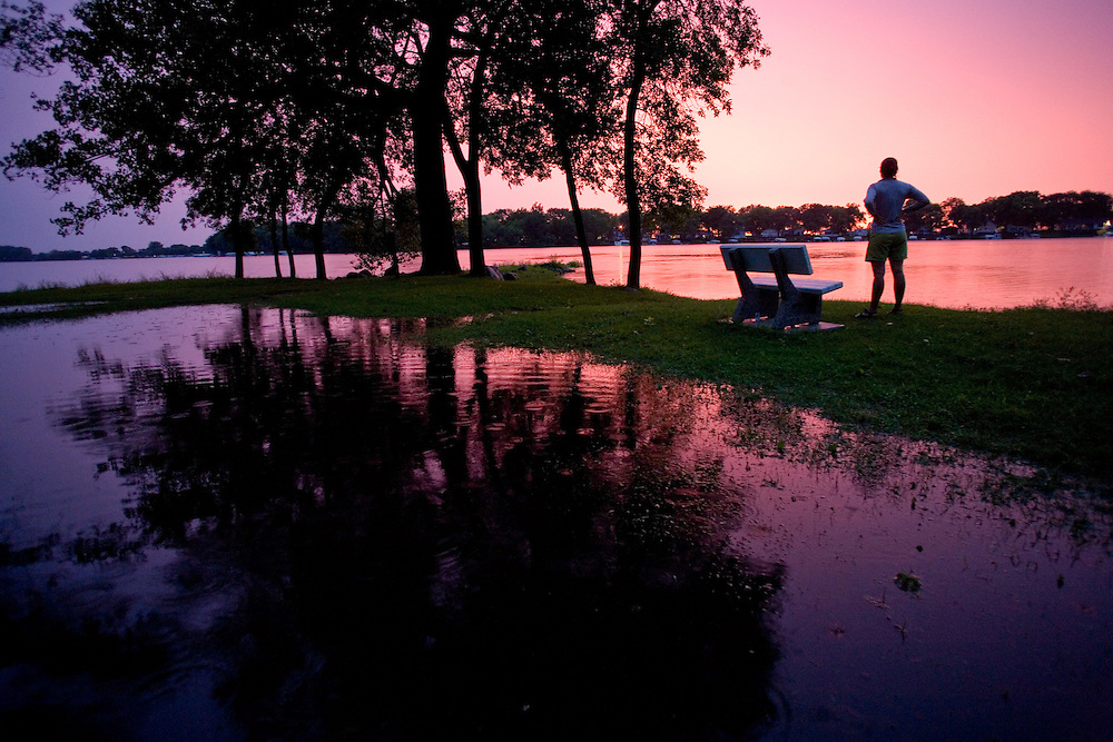 Alexis Erkert watches the sunset after heavy rains flood Twin Lakes State Park. Twin Lakes State Park, Calhoun County, Iowa, 8/22/2007 Photo by Ben Depp