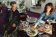 USA_SCI_BIOSPH_72_xs <br /> Biosphere 2 Project undertaken by Space Biosphere Ventures, a private ecological research firm funded by Edward P. Bass of Texas.  &lsquo;Biospherian&rsquo;s Mark Nelson and Jayne Poynter eating lunch inside Biosphere 2 with Roy Walford in background. Biosphere 2 was a privately funded experiment, designed to investigate the way in which humans interact with a small self-sufficient ecological environment, and to look at possibilities for future planetary colonization. The $30 million Biosphere covers 2.5 acres near Tucson, Arizona, and was entirely self- contained. The eight &lsquo;Biospherian&rsquo;s&rsquo; shared their air- and water-tight world with 3,800 species of plant and animal life. The project had problems with oxygen levels and food supply, and has been criticized over its scientific validity. 1990