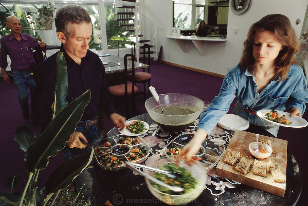 USA_SCI_BIOSPH_72_xs <br /> Biosphere 2 Project undertaken by Space Biosphere Ventures, a private ecological research firm funded by Edward P. Bass of Texas.  'Biospherian's Mark Nelson and Jayne Poynter eating lunch inside Biosphere 2 with Roy Walford in background. Biosphere 2 was a privately funded experiment, designed to investigate the way in which humans interact with a small self-sufficient ecological environment, and to look at possibilities for future planetary colonization. The $30 million Biosphere covers 2.5 acres near Tucson, Arizona, and was entirely self- contained. The eight 'Biospherian's' shared their air- and water-tight world with 3,800 species of plant and animal life. The project had problems with oxygen levels and food supply, and has been criticized over its scientific validity. 1990