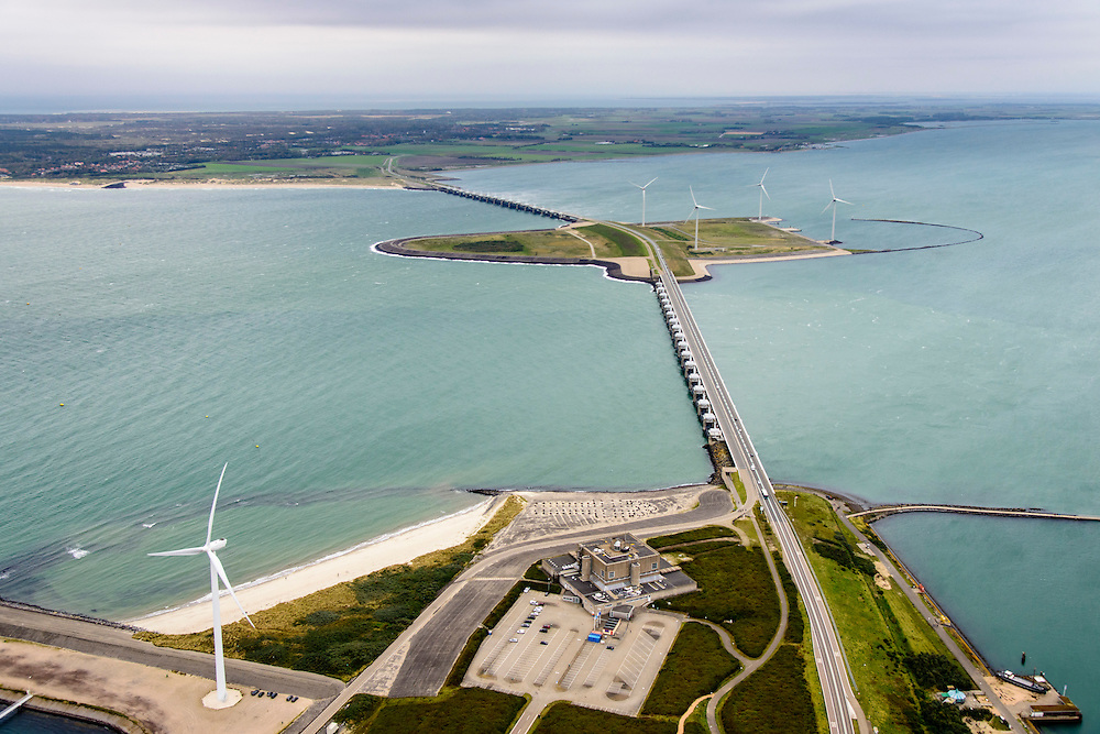 Nederland, Zeeland, Oosterschelde, 19-10-2014; Oosterschelde Stormvloedkering tussen Schouwen en Noord-Beveland. Sluitgat Schaar, werkeiland Roggenplaat, sluitgat Hammen. Schouwen-Duiveland in de achtergrond, links de Noordzee. Neeltje Jans in de voorgrond.<br /> Storm surge barrier in Oosterschelde (East Scheldt), between Islands of Schouwen-Duiveland and Noord-Beveland, North Sea on the left. Under normal circumstances the barrier is open to allow for the tide to enter and exit. In case of high tides in combination with storm, the slides are closed. <br /> luchtfoto (toeslag op standard tarieven);<br /> aerial photo (additional fee required);<br /> copyright foto/photo Siebe Swart