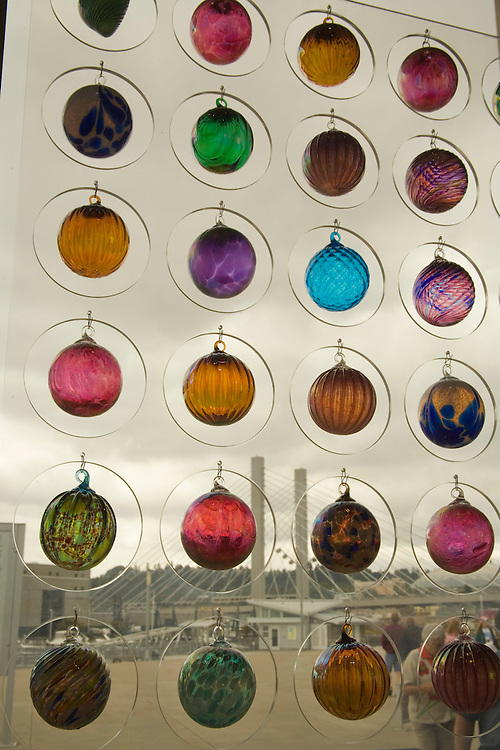 Glass balls hang in gift shop window of Museum of Glass, Tacoma, Washington, United States