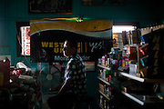 Joe Riofrio poses for a portrait in his closed store, the Westside Grocery in Mendota, Calif., September 10, 2012.