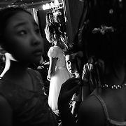 Pre-teen models wait backstage before hitting the catwalk at a fashion show in Hanoi, Vietnam. With government-instituted market reforms and a rapidly growing economy, young urban Vietnamese now have more disposable income to spend on mobile phones, slick motorbikes and up-to-date fashions. YEAR: 2004