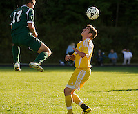 Hopkinton's Steven Auger heads the ball over Bow's Robert Lougee during NHIAA Division III Soccer Tuesday afternoon.   (Karen Bobotas/for the Concord Monitor)