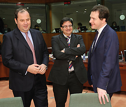 George Osborne, the UK's chancellor of the exchequer,  right, speaks with Josef Proell, Austria's finance minister, left, and Tonio Fenech, Malta's finance minister, during a meeting of EU finance ministers, at the European Council headquarters, in Brussels, Tuesday, Dec. 7, 2010. (Photo © Jock Fistick).