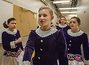 Grace Landry, of Nashua NH, practices with dance mates in the hallway during a Worlds Preview Party at Chelmsford High School featuring dancers who have qualified for the Irish Dance World Championships in Montreal, Mar. 21, 2015.   (Wicked Local Photo/James Jesson).