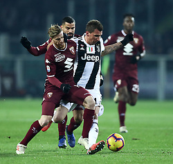 December 15, 2018 - Turin, Italy - Torino Fc V Fc Juventus - Serie A..Cristian Ansaldi of Torino and Mario Mandzukic of Juventus at Stadio Olimpico Grande Torino in Turin, Italy on December 15, 2018. (Credit Image: © Matteo Ciambelli/NurPhoto via ZUMA Press)