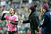 Northampton Town Striker Ricky Holmes gets instructions from Northampton Town Manager Chris Wilder  during the The FA Cup Third Round Replay match between Milton Keynes Dons and Northampton Town at stadium:mk, Milton Keynes, England on 19 January 2016. Photo by Dennis Goodwin.