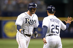 August 19, 2017 - St. Petersburg, Florida, U.S. - WILL VRAGOVIC       Times.Tampa Bay Rays first baseman Lucas Duda (21) high fives third base coach Charlie Montoyo (25) as he rounds the bases on a two run home run in the sixth inning of the game between the Seattle Mariners and the Tampa Bay Rays at Tropicana Field in St. Petersburg, Fla. on Saturday, Aug. 19, 2017. (Credit Image: © Will Vragovic/Tampa Bay Times via ZUMA Wire)