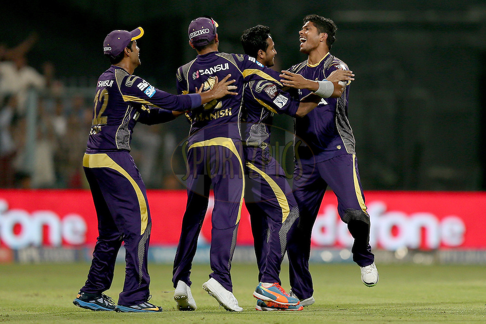 Umesh Yadav celebrates a wicket with his teammates during the first qualifier match (QF1) of the Pepsi Indian Premier League Season VII 2014 between the Kings XI Punjab and the Kolkata Knight Riders held at Eden Gardens Cricket Stadium, Kolkata, India on the 28th May 2014. Photo by Jacques Rossouw / IPL / SPORTZPICS<br /> <br /> <br /> <br /> Image use subject to terms and conditions which can be found here:  http://sportzpics.photoshelter.com/gallery/Pepsi-IPL-Image-terms-and-conditions/G00004VW1IVJ.gB0/C0000TScjhBM6ikg