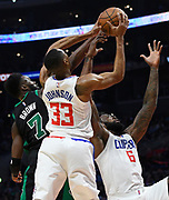Boston Celtics guard Jaylen Brown #7 can't get the ball from LA Clippers forward Wesley Johnson #33 and LA Clippers center DeAndre Jordan #6 in the second half. The Los Angeles Clippers were defeated by the Boston Celtics 113-102 in a regular season NBA matchup in Los Angeles, CA 1/025/2018 (Photo by John McCoy, Los Angeles Daily News/SCNG)