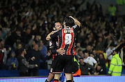 AFC Bournemouth defender Adam Smith and AFC Bournemouth midfielder Harry Arter celebrate the first goal during the Sky Bet Championship match between Brighton and Hove Albion and Bournemouth at the American Express Community Stadium, Brighton and Hove, England on 10 April 2015. Photo by Phil Duncan.