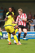 Courtney Richards and George McLennan  during the Vanarama National League match between Torquay United and Cheltenham Town at Plainmoor, Torquay, England on 29 August 2015. Photo by Antony Thompson.
