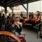 Pitcher, Monica Abbott, sits quietly before the game. <br /> <br /> Todd Spoth for The New York Times.