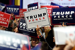 Signs in support of the Republican candidates go up at a rally with Mike Pence, Vice-presidential candidate for the Republican Party, in Bensalem, PA.