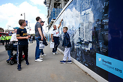 Spurs fans admire graphics of their new stadium outside White Hart Lane before the final game at the stadium before it's closure for demolition and redevelopment - Rogan Thomson/JMP - 14/05/2017 - FOOTBALL - White Hart Lane - London, England - Tottenham Hotspur v Manchester United - Premier League.