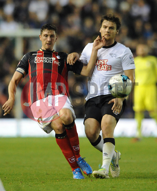 Derby County's Chris Martin closes down Bournemouth's Tommy Elphick - Photo mandatory by-line: Dougie Allward/JMP - Mobile: 07966 386802 - 30/09/2014 - SPORT - Football - Derby - Pride Park - Derby County v AFC Bournemouth - Sky Bet Championship