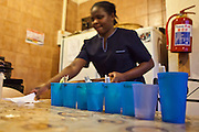 An African nurse prepares medicines for young children at Lambano Sanctuary, a hospice and care home for HIV positive children. Each blue beaker contains the treatment for a different person. The drugs include anti-retrovirals (ARVs) the treatment for HIV. Guateng, South Africa.