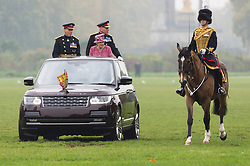 © Licensed to London News Pictures. 19/10/2017. London, UK. Queen Elizabeth II reviews The King's Troop Royal Horse<br /> Artillery in Hyde Park, on the occasion of their 70th Anniversary. The KTRHA was formed on the wishes of His Majesty King George VI in October 1947. Commonly known as the 'Gunners', The Royal Artillery provides firepower to the British Army. Equipped with 13-pounder field guns dating from WWI, the Troop provides ceremonial salutes for Royal occasions and state functions. Photo credit: Ray Tang/LNP