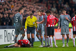 EINDHOVEN, THE NETHERLANDS - Tuesday, December 9, 2008: Liverpool's Daniel Agger, Lucas Leiva and Jamie Carragher look on as PSV Eindhoven's Danko Lazovic pretends to be injured during the final UEFA Champions League Group D match at the Philips Stadium. (Photo by David Rawcliffe/Propaganda)