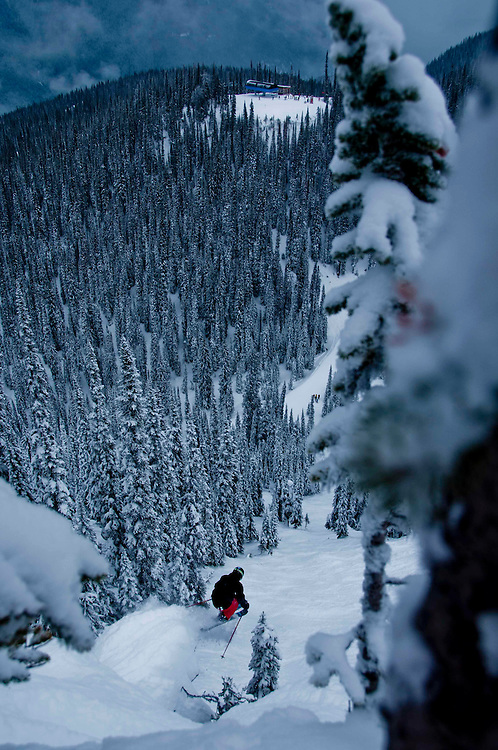 Moment team athlete and FWT competitor Caleb Mullen steps off a pillow and into the valley 40 feet below. The North Bowl, Revelstoke Mountain Resort, British Columbia