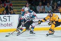 KELOWNA, CANADA - MAY 13: John Quenneville #17 of Brandon Wheat Kings stick checks Tyson Baillie #24 of Kelowna Rockets during second period on May 13, 2015 during game 4 of the WHL final series at Prospera Place in Kelowna, British Columbia, Canada.  (Photo by Marissa Baecker/Shoot the Breeze)  *** Local Caption *** Tyson Baillie; John Quenneville;