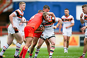 Bradford Bulls half half Cory Aston (41) is tackled during the Kingstone Press Championship match between Sheffield Eagles and Bradford Bulls at, The Beaumont Legal Stadium, Wakefield, United Kingdom on 3 September 2017. Photo by Simon Davies.
