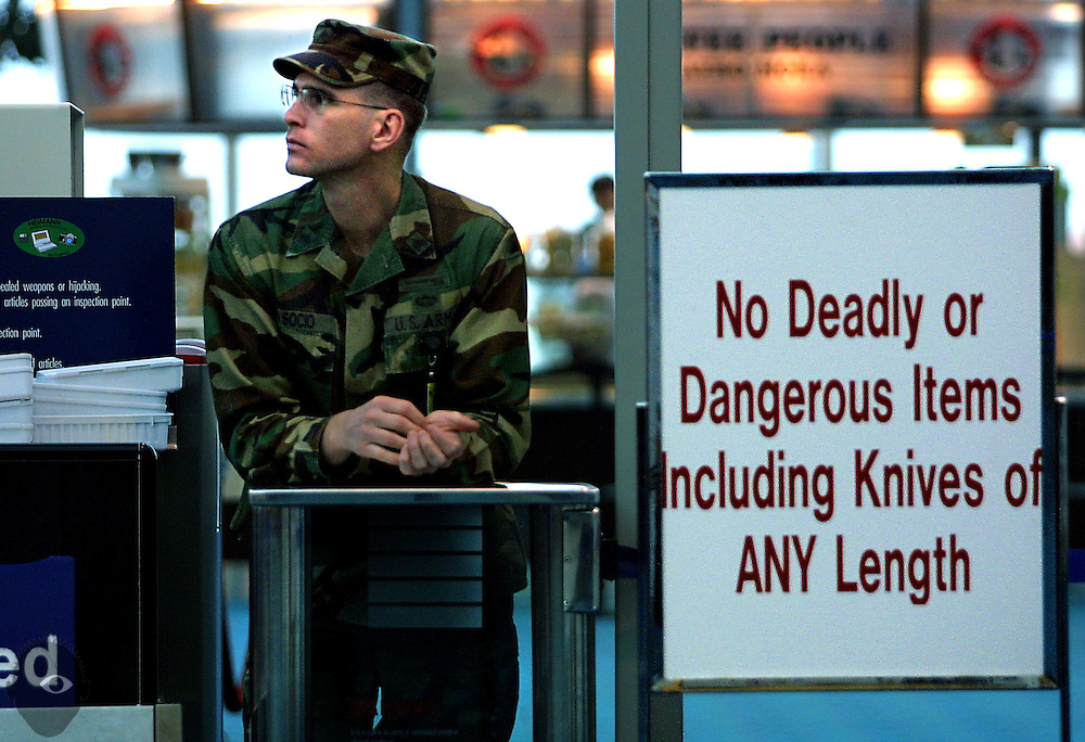 U.S. Army Reservist Socio mans a concourse checkpoint at the Portland International Airport as part of increased security measures there.