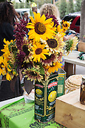 sunflowers in olive oil can vase