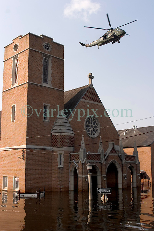 05 Sept  2005. New Orleans, Louisiana. Post hurricane Katrina.<br /> On patrol in Uptown New Orleans off Napolean Ave following the devastating floods. An army helicopter hovers over a devastated church.<br /> Photo; ©Charlie Varley/varleypix.com