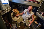 Conrad Tolby, a long-distance truck driver and ex-biker in the cab of his semi tractor trailer at the Flying J truck stop in Effingham, Illinois. (Conrad Tolby is featured in the book What I Eat: Around the World in 80 Diets.) MODEL RELEASED.