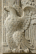 Closeup of stone carving at the base of National Archives Building, Washington, DC. The detail depicts the symbolic  American eagle.