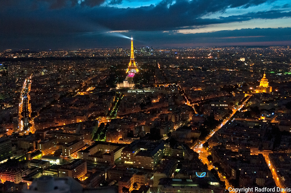Eiffel Tower and the city of Paris, France, at night.