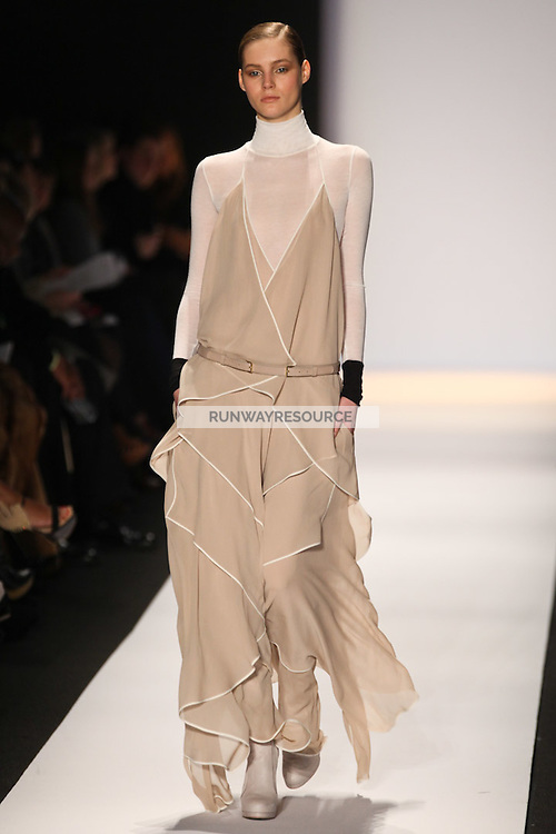 Juju Ivanyuk walks the runway wearing BCBG Max Azria Collection Fall 2011 during Mercedes-Benz Fashion Week in New York on February 10, 2011